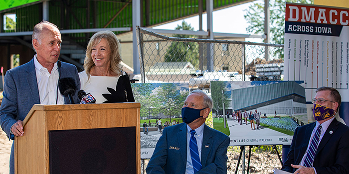 Mark and Jill Oman speak at a press conference announcing their $1 million gift to UNI@DMACC Building Community Project Fund.
