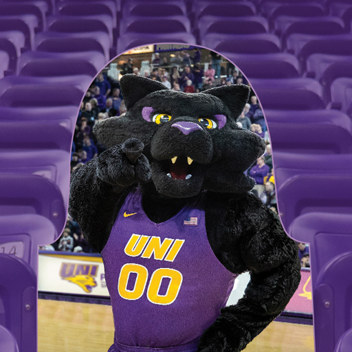 Cardboard cutout of TC in a seat at the McLeod Center